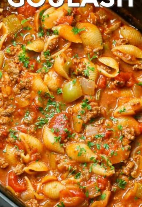 Crockpot Goulash is an easy to make slow cooker meal! Tender ground beef, bell p...