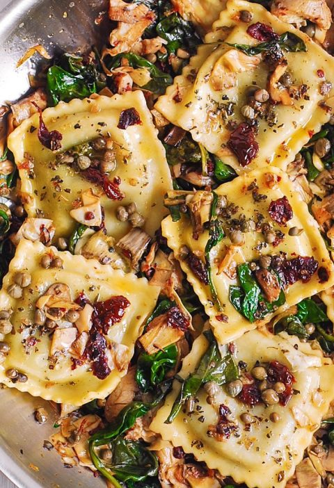 Ravioli with Spinach, Artichokes, Capers, Sun-Dried Tomatoes.  Vegetables are sa...