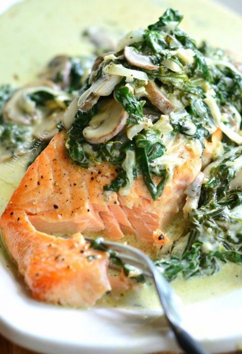 This Salmon Florentine recipe is made with tender baked salmon and topped with c...