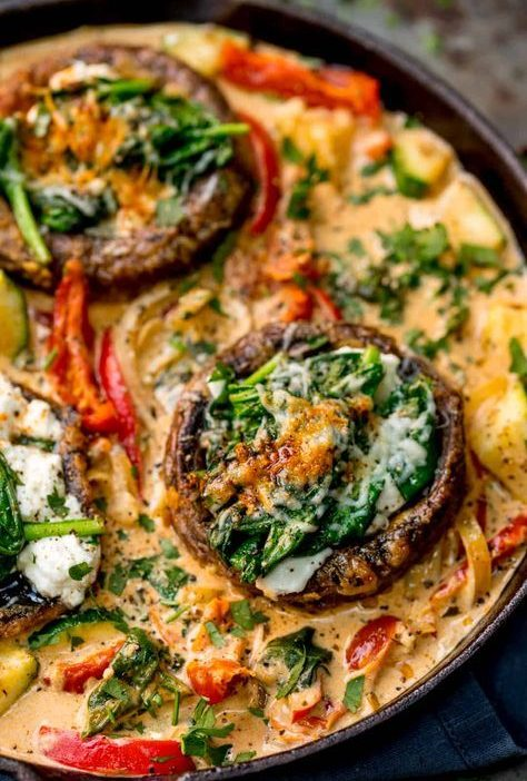 Tuscan Style Stuffed Mushrooms in Creamy Sun Dried Tomato Sauce makes a great ve...