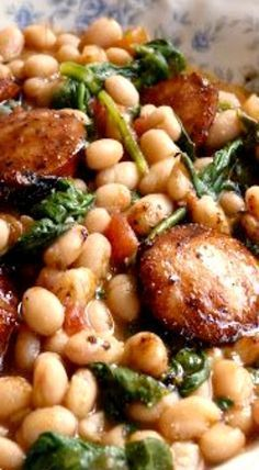 White Beans with Spinach and Sausage. Used turkey kielbasa and only a dash of or...