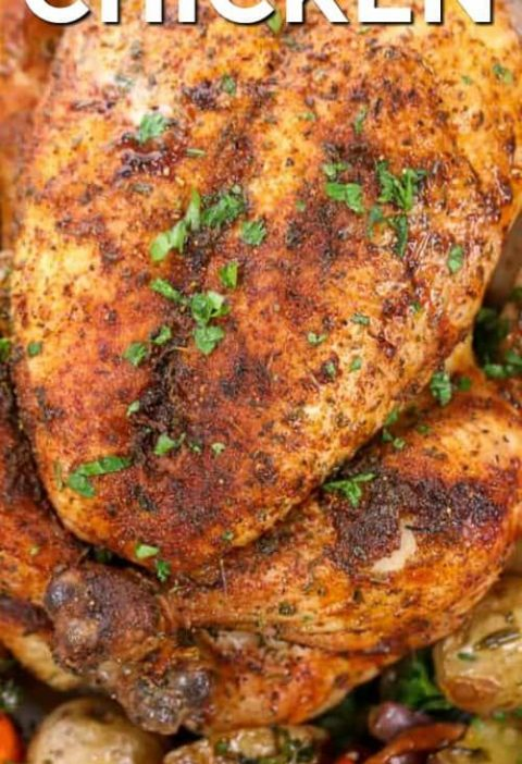 This juicy whole roast chicken is the easiest oven baked chicken recipe ever. We...