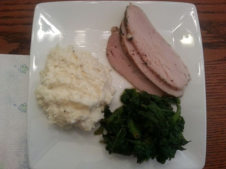 Comfort food at its healthiest! Crockpot pork loin, mashed cauliflower, and gree...