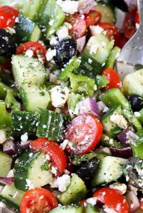 Greek salad is a fresh and simple summer side dish perfect for potlucks and part...